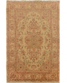 This is a Tabriz Hand Made Area Rug from China. It measures about 4 by 6 and is available at our online rug store.
